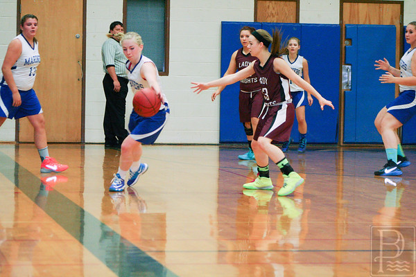 sports; DIS; girls; ball; Nov.24; holli; 120414; dishs; girls basketball; marienrs; sports Senior Holli Boyce keeps clear of the Narraguagus defense. Photo by Anne Berleant