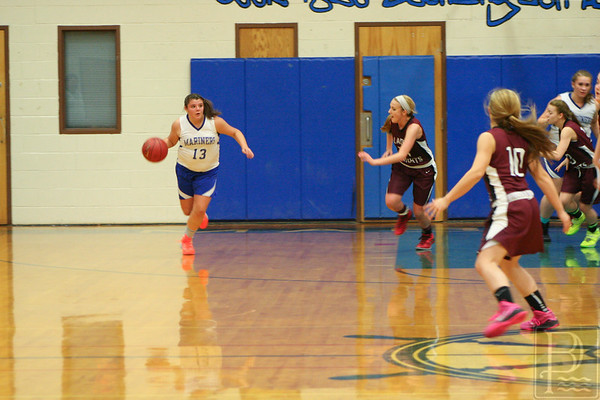 sports; DIS; girls; ball; Nov.24; dribble; 120414; dishs; girls basketball; marienrs; sports Junior Allyson Eaton handles the ball down court. Photo by Anne Berleant