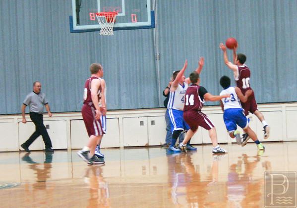 Sports; DIS; boys; ball; Nov.24; defense; 120414; Mariners; Narraguagus; basketball; dishs The team defends against Narraguagus. Photo by Anne Berleant