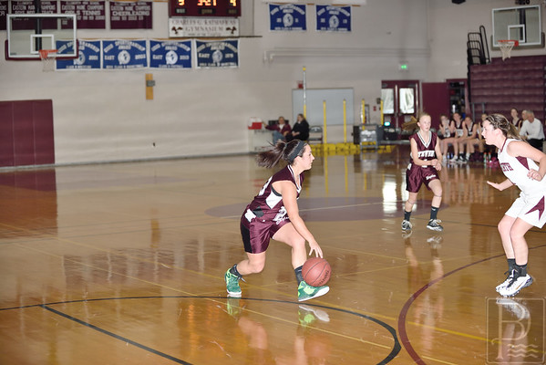 Sports; gsa; girls; scrimmage; EHS; Nov22; 188; Nowland; One; 120414; Eagles; GSA; George Stevens Academy; basketball; game; high school; school; sport; sports; team Senior Megan Nowland faces the Ellsworth defense. Photo by Franklin Brown