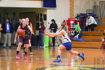 sports; DIS; girls; ball; Nov.24; pass; two; 120414; dishs; girls basketball; marienrs; sports Junior Ashley Haskell reaches for a pass against Narraguagus. Photo by Anne Berleant