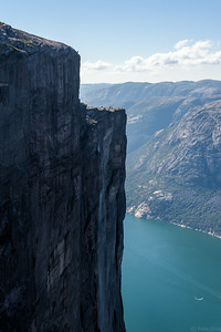View from Kjeragbolten, enlarge to see the base jumpers approaching the edge.