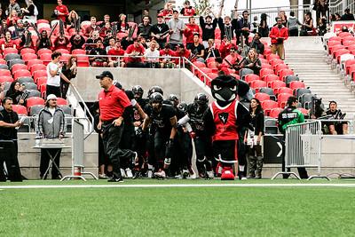 Coach Sumarah leads his team onto the field.