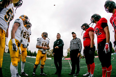 Carleton alumnus James Duthie with the coin toss