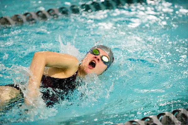 Cedar Slagle swims the 100 yard freestyle event