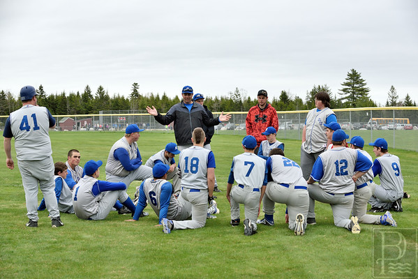 "Sports; DIS; GSA; ball; huddle; 051415; DIS; Deer IsleStonington High School; Eagles; GSA; George Stevens Academy; Mariners; baseball; dishs; game; high school; school; sport; sports; team ""We have some work to do."" Coach Talbot tells his Mariners. Photo by Franklin Brown"