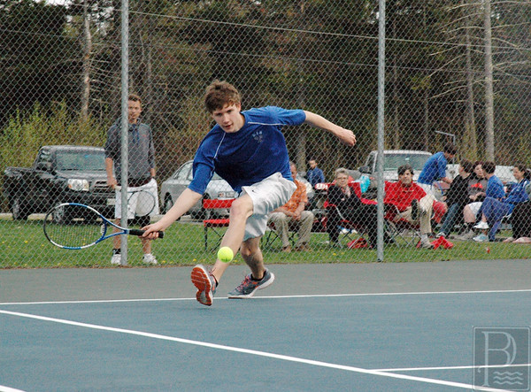 Sports; DIS; tennis; GSA; Paul; 052115; DIS; Deer IsleStonington High School; Mariners; dishs; game; high school; school; sport; sports; team; tennis Paul Zoephel reaches for a low bounce in a match against GSA. Photo by Jack Scott