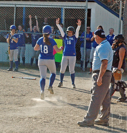 Spors; DIS; softball; logan; morgan; homerun; 052115; SBBBBangorChrist0515; game; high school; school; sport; sports; team Logan Eaton scores a run against Bangor Christian, to cheers from Morgan Shepard. Photo by Jack Scott