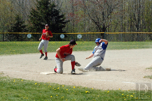 Zack Ladd slides onto base