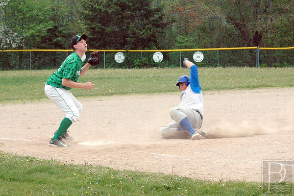 Sports; DIS; Schenck; EthanSlidesintoThird; 060415; DIS; Deer IsleStonington High School; Mariners; dishs; game; high school; school; sports; team Ethan Shepard slides into third base. Photo by Jack Scott