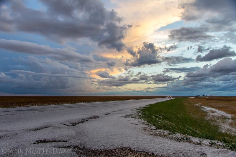 Sunset near Ransom, KS with hail covered roads.