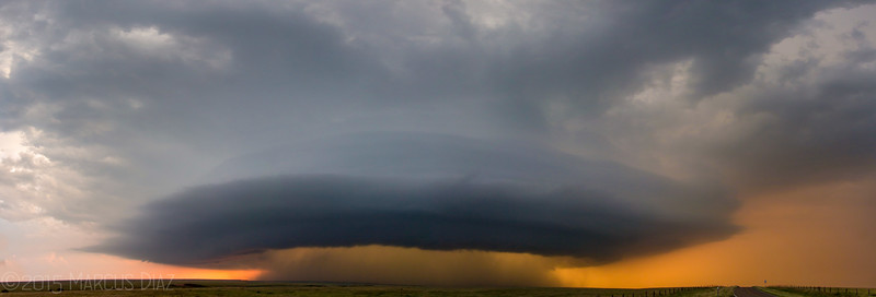 This 4 pic stitched panoramic was the climax of the chase. We were south of Umbarger, TX looking back at this behemoth space ship updraft at sunset. Took us a good hour of hard driving, but it was so worth it!