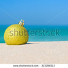 35_stock-photo-golden-christmas-tree-ball-on-ocean-beach-sand-winter-holidays-in-hot-countries-concept-321098513