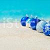 34_stock-photo-49610136-christmas-tree-decorations-on-sea-sandy-beach