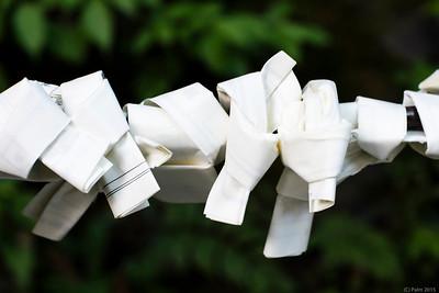 Getting rid of a not so good fortune telling paper, Kibune shrine.