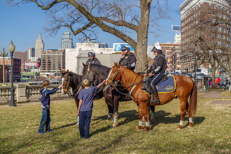 Three Cops, Three Horses, Two Kids, and a Phone