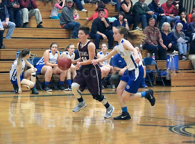 GSA's Dawn Hutchinson moves the ball  past Mariner Jessalyn Gove. Photo by Anne Berleant