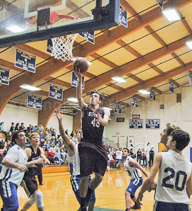 Jarrod Chase goes for the lay up. Photo by Jack Scott
