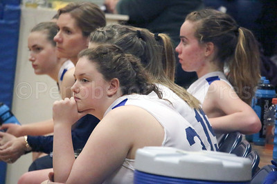 Brienna Limburner watches from the Mariner bench. Photo by Anne Berleant
