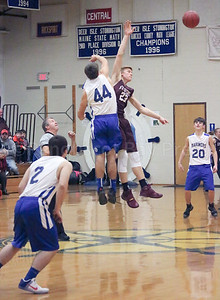 Max Mattson gets the tip-off. Photo by Anne Berleant