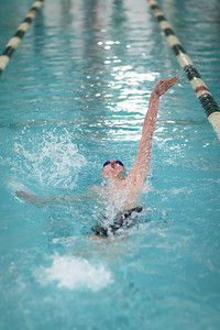 Jeremiah Scheff competes in the Men's 100Yard Back Stroke. Photo by Tate Yoder