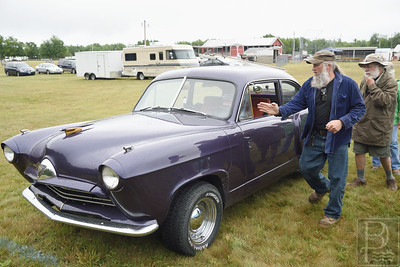 Complete with a Hydraulic Hood  Glenn Showers of Deer Isle, who specializes in autobody and customizing, talks about his customized 1953 Kaiser Henry J.  The chasis is a 1969 Chevy Nova suspension along with homemade skirts and scoops on the rear quarters.  The nose and rear of the car have also been lengthened.  Showers even installed a hydraulic system to open the hood automatically.  Photo by Franklin Brown