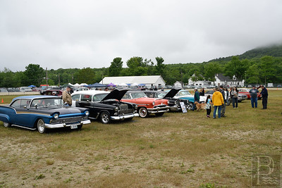1st Rainy Car Show in 15 Years.  Despite the rainy weather spectators and participants walk the Blue Hill Fairgrounds to view a variety of new and classic automobiles.  Photo by Franklin Brown.