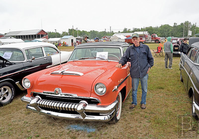 America's First Transparent Car  Fernald Leach of Blue Hill stands next to his 1954 Mercury Sun Valley.  This car has a plexiglass roof and was referred to by Mercury as America's First Transparent car.  Leach who once did autobody work, restored the car body himself.  The car originally came from California.  Photo by Franklin Brown