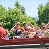 All aboard!<br /> <br /> Several children wave to passersby as the Castine Fire Department offered free firetruck rides around the block during July 4th.  Photo by Franklin Brown