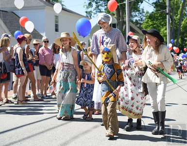 History and Ancient History Eden Klein (front) marches in his Samurai costume while in back, Brenna Pietila, Myla Pietila, Esther Reed, Elizabeth Reed and Mary Reed march in their historical costumes.  Photo by Franklin Brown