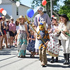 History and Ancient History<br /> Eden Klein (front) marches in his Samurai costume while in back, Brenna Pietila, Myla Pietila, Esther Reed, Elizabeth Reed and Mary Reed march in their historical costumes.  Photo by Franklin Brown