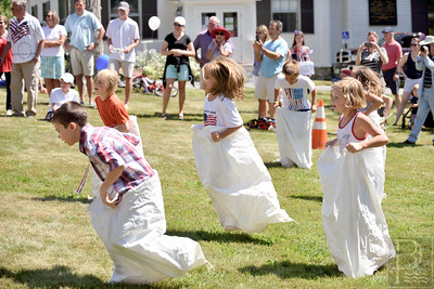 And They're Off.. Dozens of children participated in a sack race after the children's costume parade.  The last race was for a cash prize.  Photo by Franklin Brown