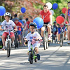 Leading the Way<br /> Scores of children on bikes lead the way up and down Court Street for the annual Children's Costume Parade.  Photo by Franklin Brown