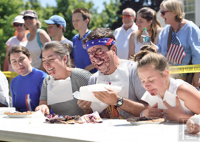 The Results Are In Show left to right, Kathanger Norin, Sopfie Jofre, Danny Jones and Kendra Boerem finish the pie eating contest.  Danny Jones came in first place.  Photo by Franklin Brown
