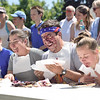 The Results Are In<br /> Show left to right, Kathanger Norin, Sopfie Jofre, Danny Jones and Kendra Boerem finish the pie eating contest.  Danny Jones came in first place.  Photo by Franklin Brown