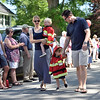 Future Firefighters...perhaps?<br /> <br /> Two boys dressed in firefighter customes march with Mom and Dad in the children's custome parade.  Photo by Franklin Brown