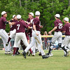 GSA players celebrate their win against Mattanawcook Academy after outing them in the top of the 7th inning.  Photo by Franklin Brown