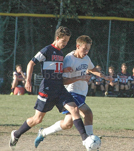 DIS' Mason Oliver battles for the ball. Photo by Jack Scott