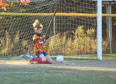 Mariner Jessalyn Gove makes a save. Photo by Jack Scot.