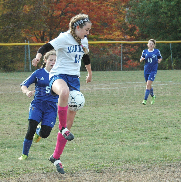 Mariner Lilly Gray maintains control. against Searsport. Photo by Jack Scott