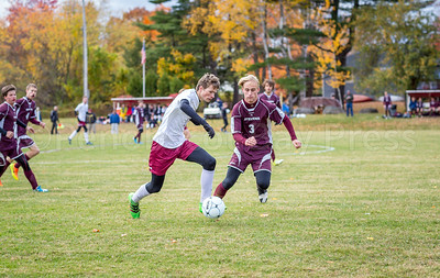 Sam Scheff defends the ball. Photo by Tate Yoder