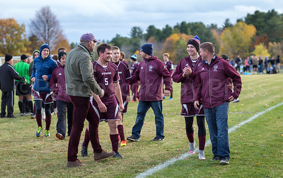The Eagles celebrate their upset win with Coach Mark Ensworth and, at left, head of School Tim Seeley. Photo by Tate Yoder