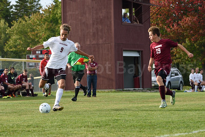 Walker Ellsworth dribbles the ball down the field against Orono.  Photo by Franklin Brown