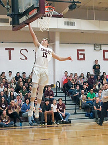 Taylor Schildroth takes off for the layup. Photo by Anne Berleant