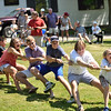 We need a few more on this side...<br /> <br /> Dozens of kids young and old participated in a tug-o-war.  Unfortunately, too few on this end caused them to lose to the other side.  Photo by Franklin Brown