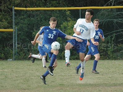 Arthur Valente works for the ball against Searsport. Photo by jack Scott