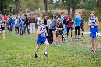 Mariner Trevor Cochrane competes in the unseeded boys section of the Festival of Champions, cheered on by Brendan Penfold, who placed 28th. Photo by Tate Yoder