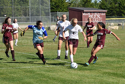 Hattie Slayton makes a move to break through WA in the last few minutes of the game.  Photo by Franklin Brown