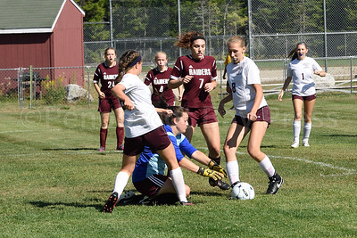 Katie Forrest, left, and Naydia Stanhope try to beat the Washington Academy Raiders goalie to the ball.  Photo by Franklin Brown