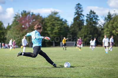 Goalie Alec Witham kicks against Washington Academy. Photo by Tate Yoder